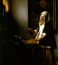 Vermeer_woman_holding_a_balance